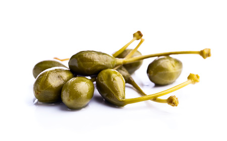 canned capers isolated on a white background