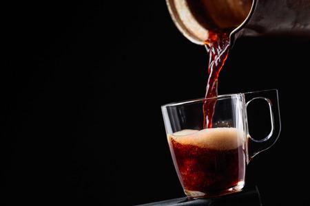 Foto de Small cup of coffee on a black background. Copy space. - Imagen libre de derechos