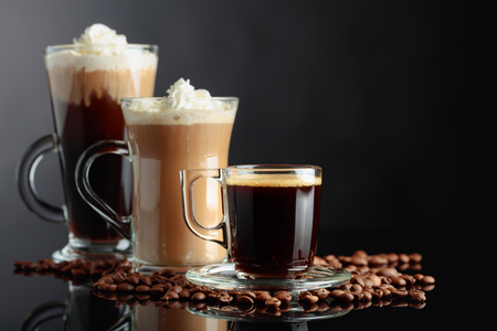 Foto de Various coffee drinks on black reflective background. Copy space. - Imagen libre de derechos
