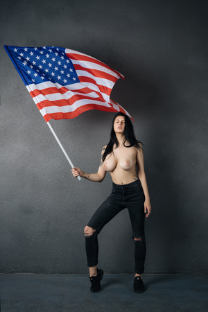 beautiful girl posing topless with American flag