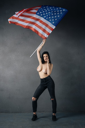 beautiful girl poses topless with american flag