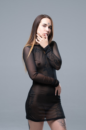 Photo pour young beautiful girl in black transparent dress - image libre de droit