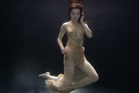 beautiful nude girl under the water
