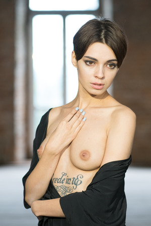 portrait of a young beautiful girl posing topless
