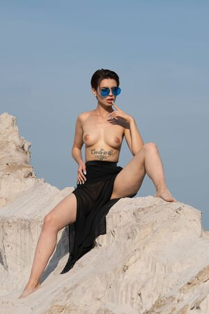 young beautiful girl posing nude outside