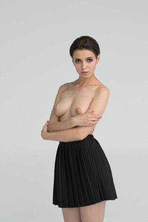 young beautiful girl posing nude in studio