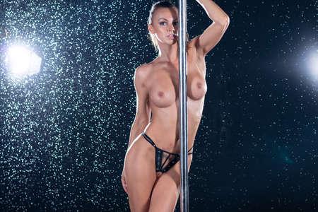 Photo pour young beautiful woman dancing around the pole nude - image libre de droit