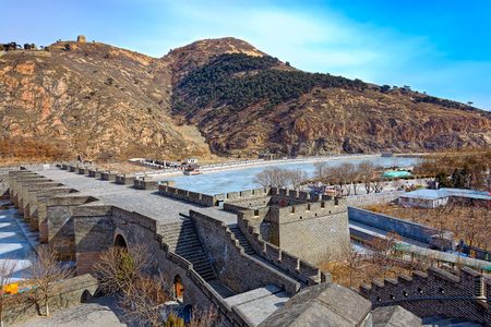 Nine-Arch Bridge and Great Wall at Nine Water Gates section of the Great Wall known as the Great Wall over Water. Jiumenkou Great Wall is located in Suizhong county in Huludao and is the eastern portion of the Jizhen Great Wall