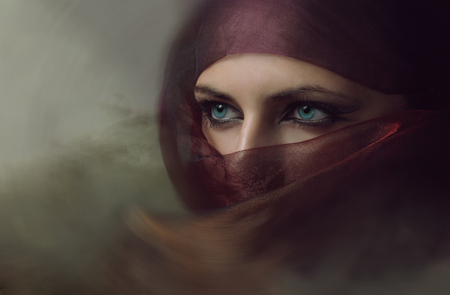 Young arabian woman in hijab with sexy blue eyes. Yashmak.の写真素材