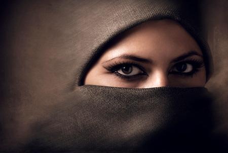 Photo pour Young arabian woman in hijab. Yashmak. - image libre de droit
