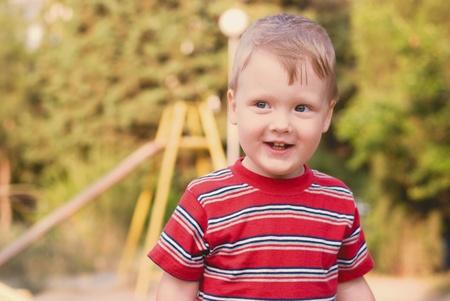 Photo pour a young boy on playground - image libre de droit