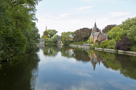 The Minnewater, Brugges. Minnewater lake is a canalized lake in Bruges, Belgium. The Dutch word Minne meaning love