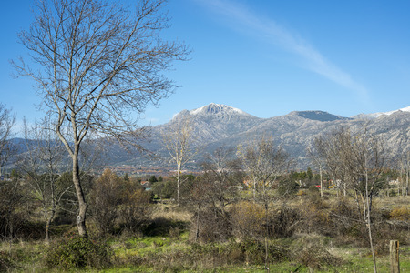 Views of the city of Cerceda, in the province of Madrid, Spain. In the background it can be seen The Maliciosa Peak, with 2.227 m.