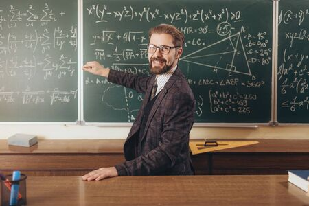 Photo for Cheerful Bearded Professor in Glasses Explaining the Formulas - Royalty Free Image