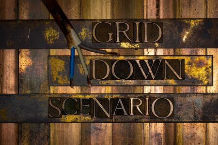 Photo of real authentic typeset letters Grid Down Scenario text on vintage textured grunge copper and gold background with electrical wiring