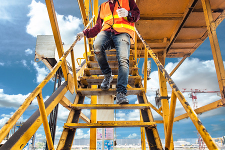 Photo pour worker, engineering wearing safety shoe with set of safety and security regulation, walking in mind step on the steel gangway bridge at workplace, working in high stage & level of insurance - image libre de droit