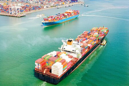 Photo pour top aerial view of the large TEU containers ships arrival and departure the port, carriage the shipment from loading port to destination discharging port, transport and logistics service to worldwide - image libre de droit