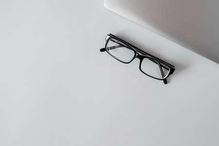 Folded fashion reading glasses for woman or unisex on white background