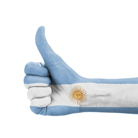 Hand with thumb up, Argentina flag painted as symbol of excellence, achievement, good - isolated on white background