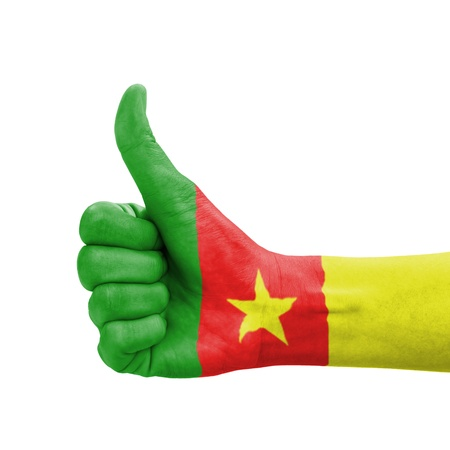 Hand with thumb up, Cameroon flag painted as symbol of excellence, achievement, good - isolated on white background