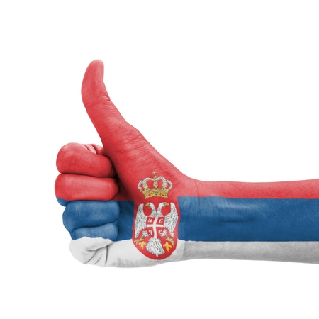 Hand with thumb up, Serbia flag painted as symbol of excellence, achievement, good - isolated on white background