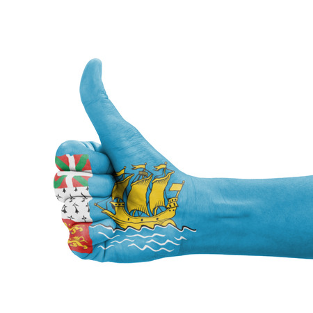 Hand with thumb up, Saint Pierre and Miquelon flag painted as symbol of excellence, achievement, good - isolated on white background