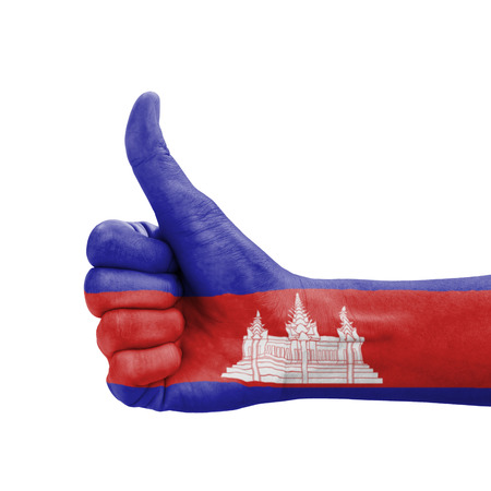 Hand with thumb up, Cambodia flag painted as symbol of excellence, achievement, good - isolated on white background