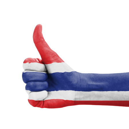 Hand with thumb up, Thailand flag painted as symbol of excellence, achievement, good - isolated on white background