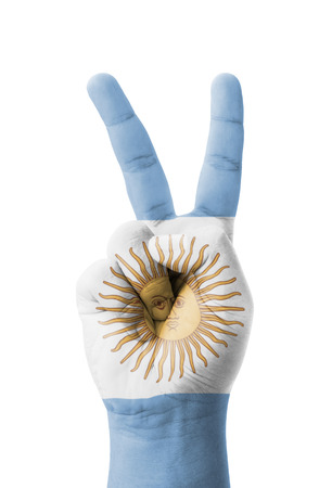 Hand making the V sign, Argentina flag painted as symbol of victory, win, success - isolated on white background