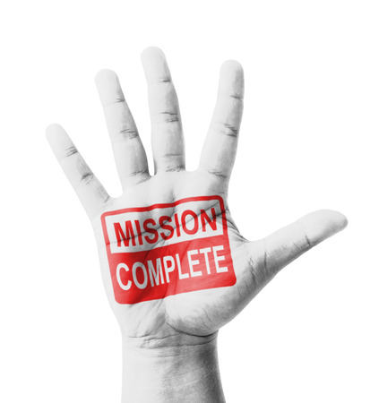 Open hand raised, Mission Complete sign painted, multi purpose concept - isolated on white background