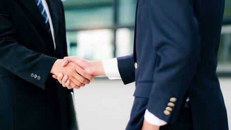 Photo for Businessmans handshake. Successful businessmen handshaking after good deal. Business partnership meeting concept. - Royalty Free Image