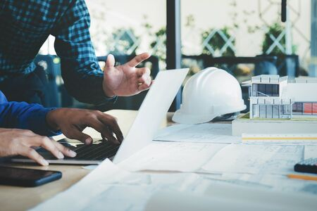Photo for Image of engineer meeting for architectural project working with partner and engineering tools on workplace. - Royalty Free Image