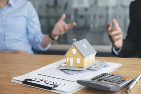 Photo pour Customer signing contract for a new house. Real estate buy or rent or sale house and insurance or loan real estate. - image libre de droit