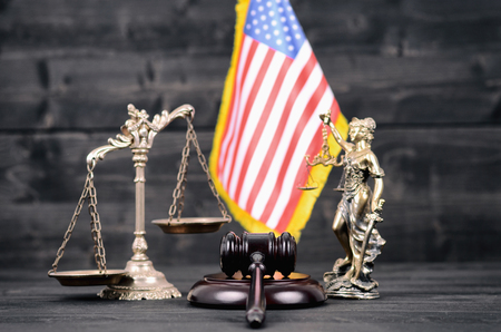Law and Justice , Legality concept, Judge Gavel, Lady Justice, Scales of Justice and USA flag on a black wooden background.