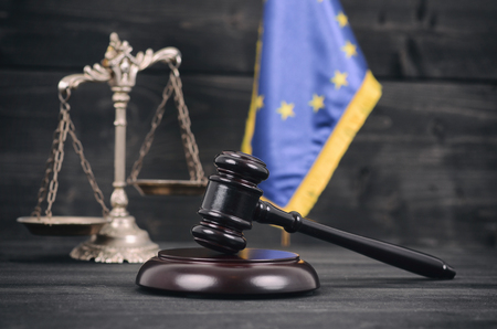 Foto de Law and Justice , Legality concept, Scales of Justice, Judge Gavel andFlag of the European Union on a black wooden background. - Imagen libre de derechos
