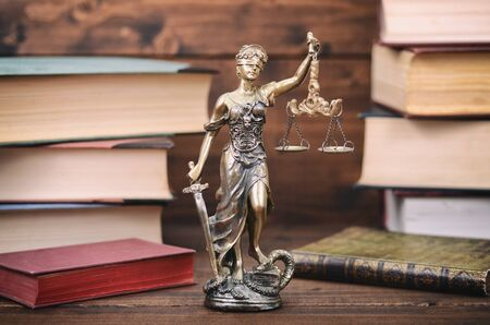 Law and Justice, Scales of Justice, Justitia, Lady Justice, law library concept, Law books in the background.