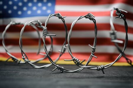 Photo pour Barbed wire and United States of America flag , immigration  concept. - image libre de droit