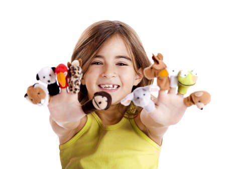 Cute and happy girl playing with finger puppets