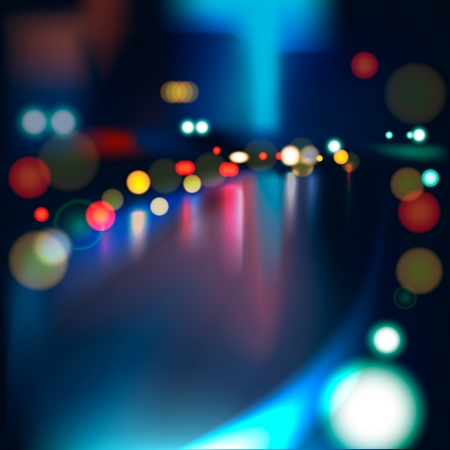 Blurred Defocused Lights of Heavy Traffic on a Wet Rainy City Road at Night
