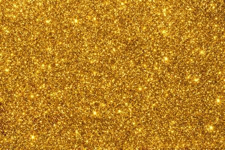 Photo pour Gold shimmering glitter for texture or background - image libre de droit