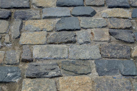 Photo for granite stone pavement texture. Abstract background of old cobble stone pavement closeup. - Royalty Free Image