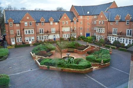 Photo pour Red brick houses with garden - image libre de droit