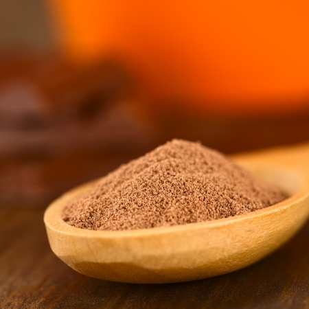 Cocoa powder on wooden spoon  Very Shallow Depth of Field, Focus one third into the cocoa