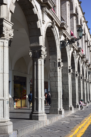 AREQUIPA, PERU - AUGUST 22, 2014: The archway of Paseo Portal de Flores on Plaza de Armas (main square) on August 22, 2014 in Arequipa, Peru. The city center of Arequipa is UNESCO World Cultural Heritage Site.