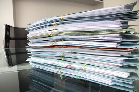 file stack on office desk