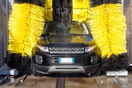 Automobile through a car wash machine