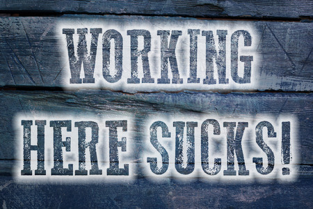 Working Here Sucks Concept text on background