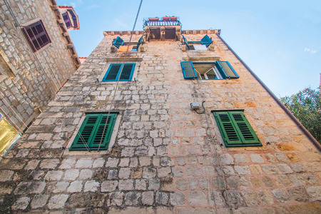 Old stone houses facades in the old town of Dubrovnik, Croatia, wide angle