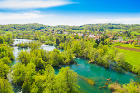 Photo for Croatia, green countryside, Mreznica river from air, panoramic view of Belavici village, waterfalls in spring, popular tourist camping resort destination - Royalty Free Image