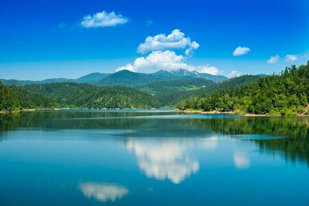 Photo pour Croatia, beautiful lake in Gorski kotar, Lokve, Risnjak mountain in background, reflection in watter - image libre de droit